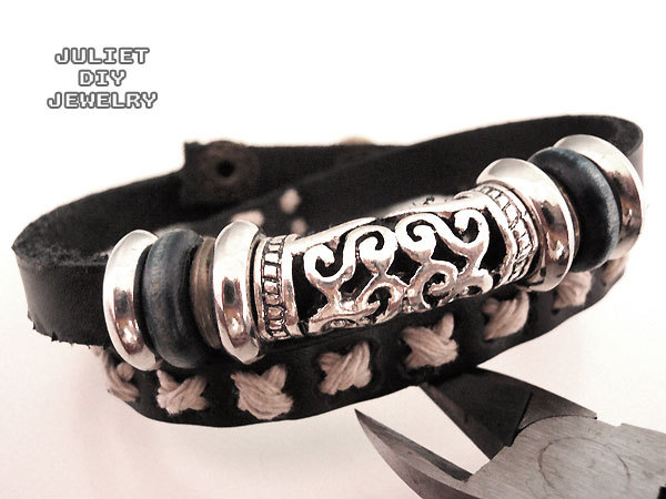 Black leather double wrap bracelet with ancient looking silver tube