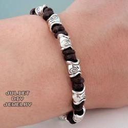 Tribal style silver fish bead hemp bracelet